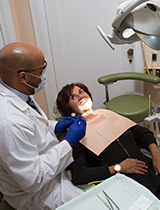 Dentist holding instrument with patient